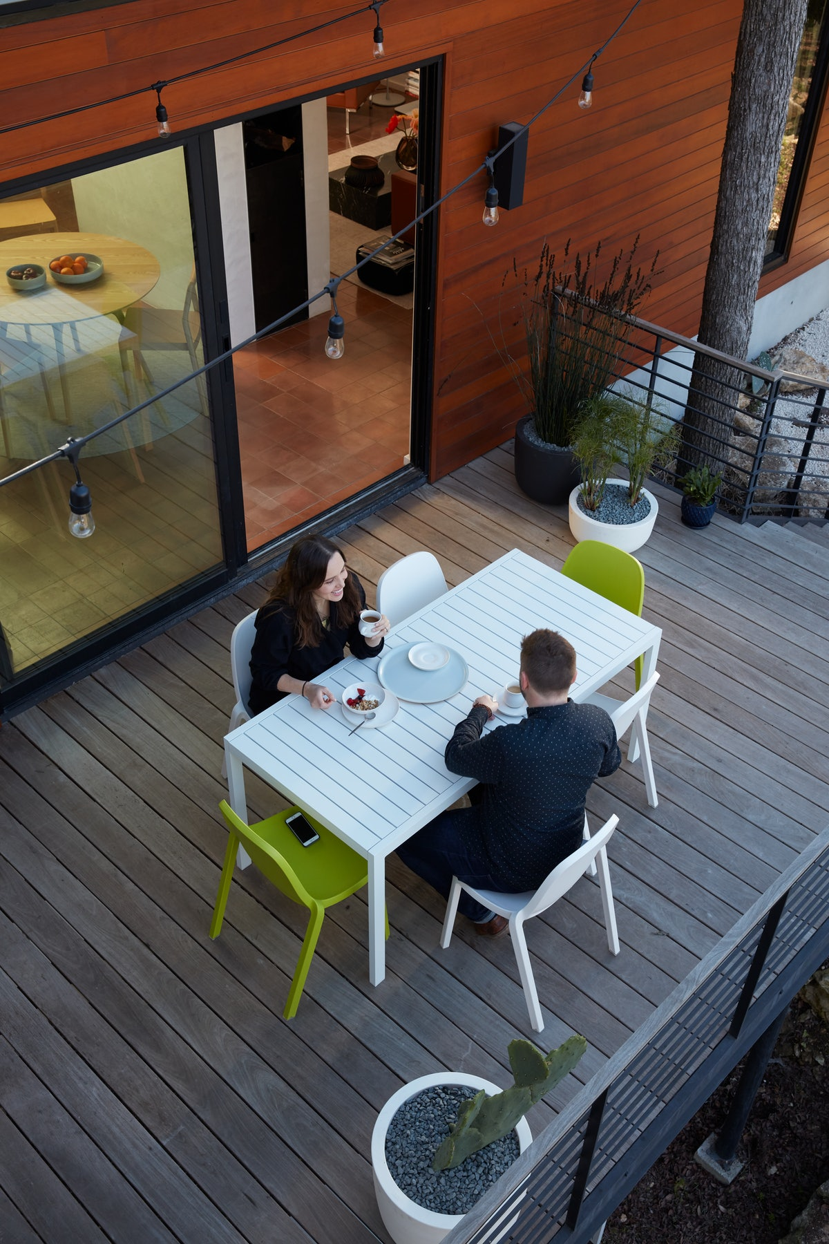 Kittridge homeowners at outdoor dining table