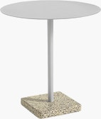 A round Terrazzo Table in light grey with a grey Terrazzo base.