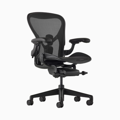 Black matte Aeron Chair on a white background with a 5-star base and ergonomic back support, angled view of the chair front.