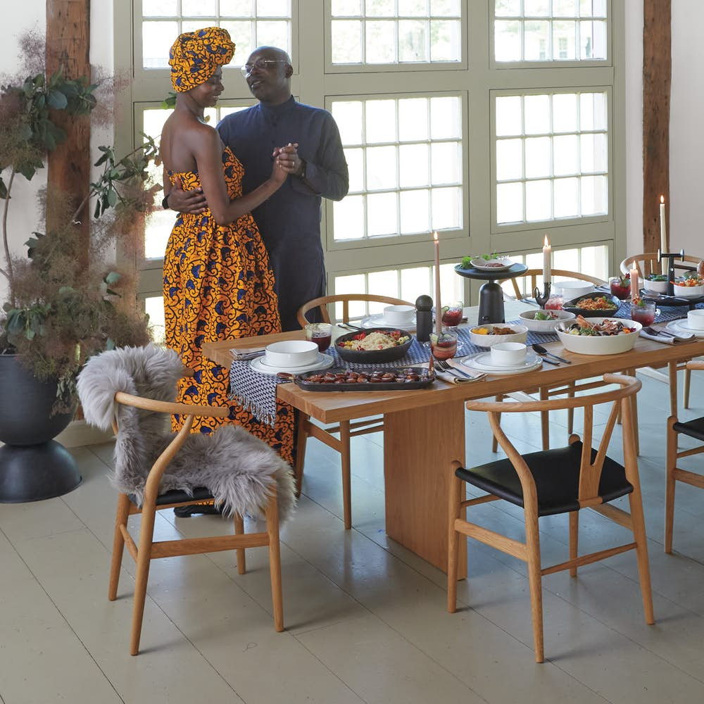 Chid Liberty and Georgie Badiel hosting dinner at Gather Table with Wishbone Chairs