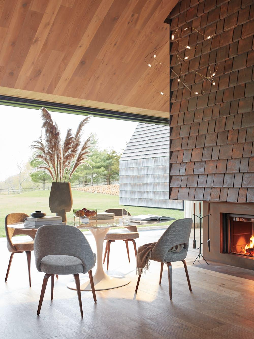 Saarinen Oval Dining with Saarinen Executive Chairs in outdoor/indoor dining room with pendant dimmed