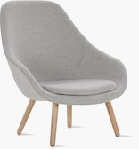 A light grey About A Lounge 92 Armchair with high back viewed from an angle