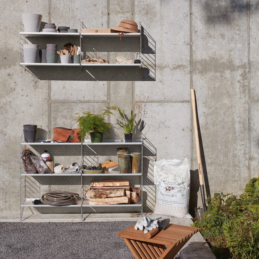 String Galvanized Wall and Floor Shelving on Concrete Wall