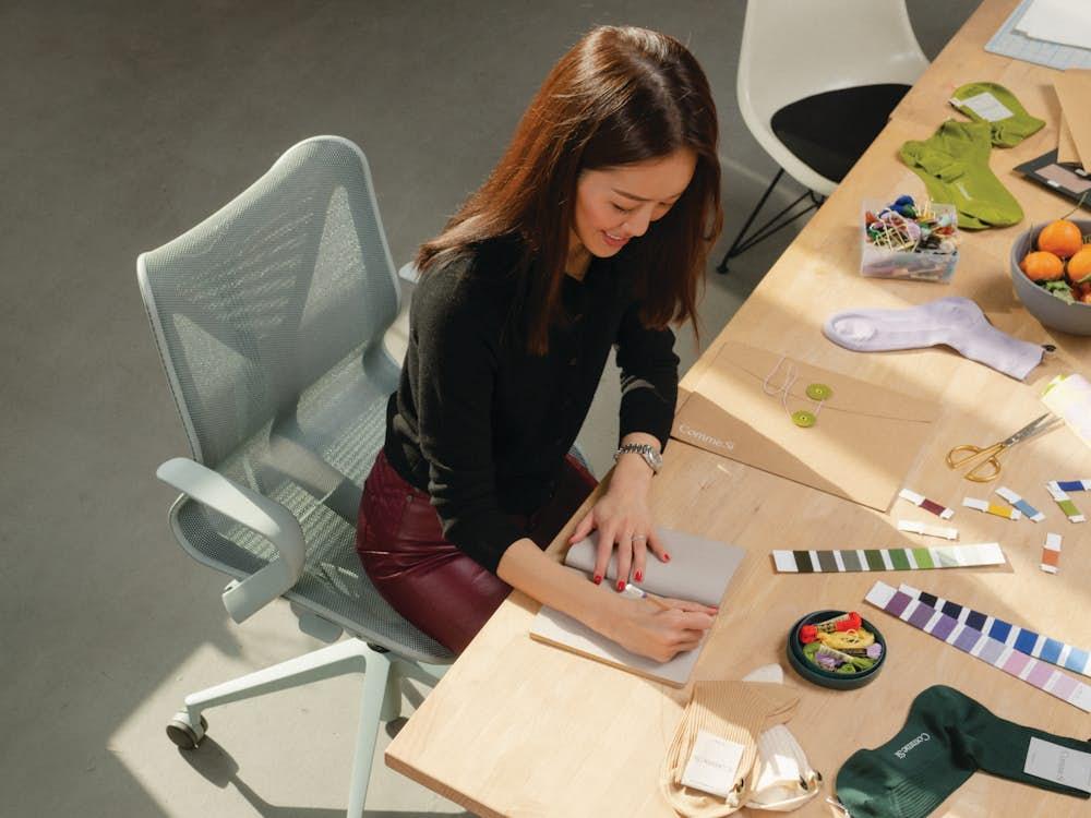 Jenni Li with Cosm Chair