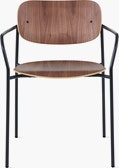 Portrait Chair with Walnut seat and back, and black frame with arms.