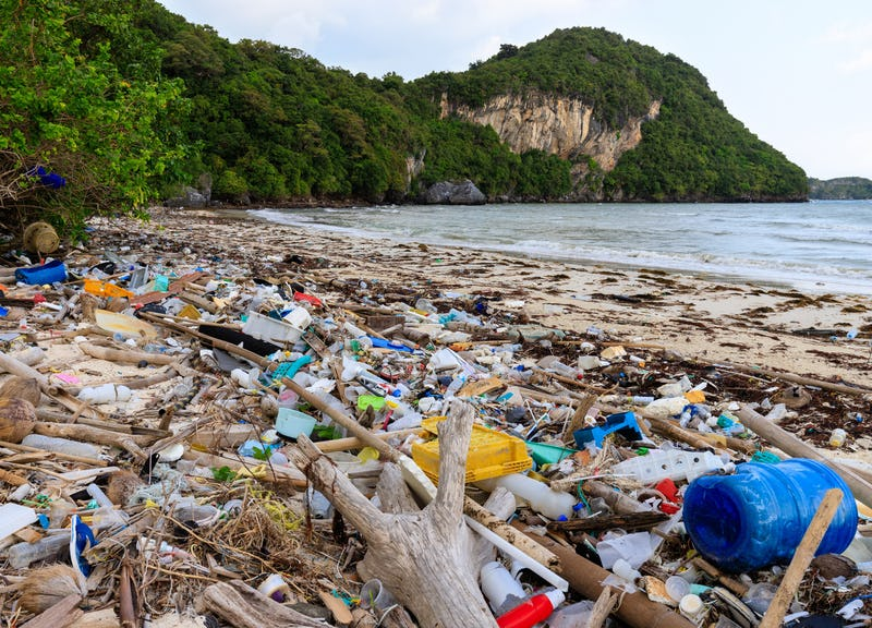 A beach littered with plastic trash.