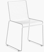 A three quarter angle view of a white Hee Dining Chair.