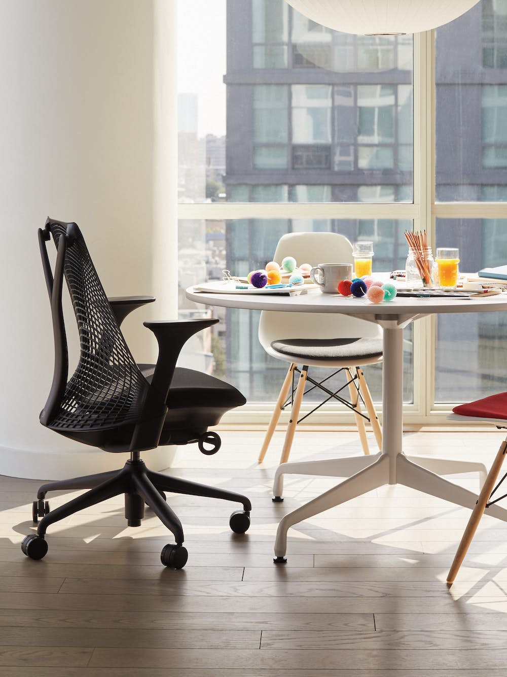 Eames Table with Round Top and Segmented Base with Sayl Chair and Eames Shell Side Chairs with Seatpad