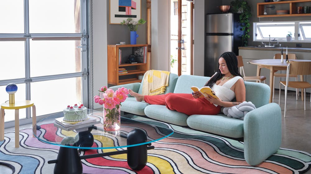 Jasmine Archie with Wilkes and Wavy rug in her living room