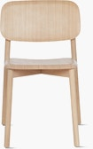 A matte lacquered oak Soft Edge 12 Side Chair viewed from the front