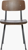 A smoke lacquered oak Result Chair with black base viewed from the front