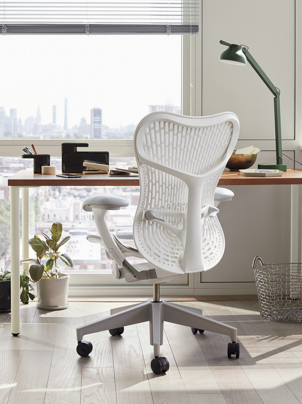 Grey and white Mirra 2 chair with brown and white OE1 Rectangular Table in a home office setting.