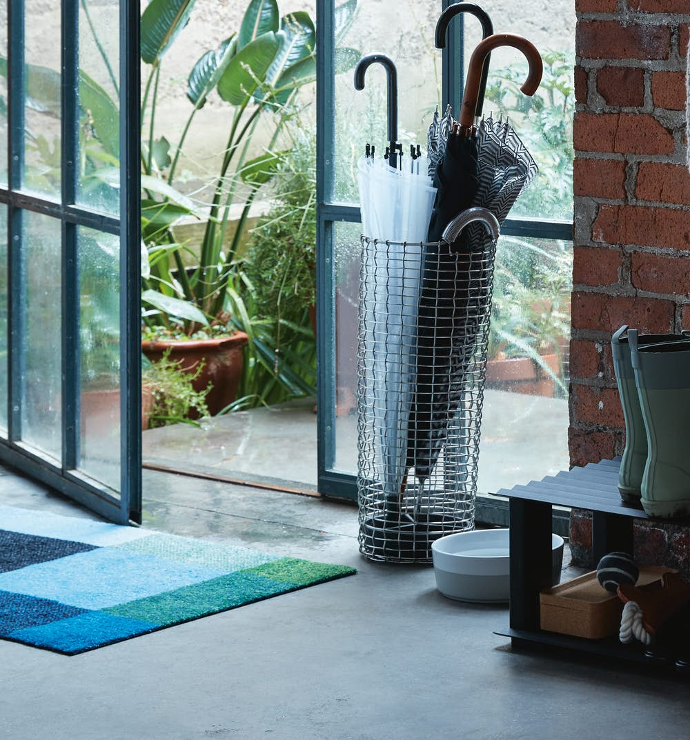 Shoe Mat and Umbrella Stand in Entryway