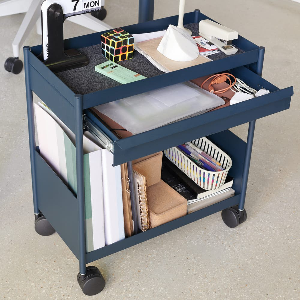 Blue OE1 Storage Trolley with casters in home office setting.