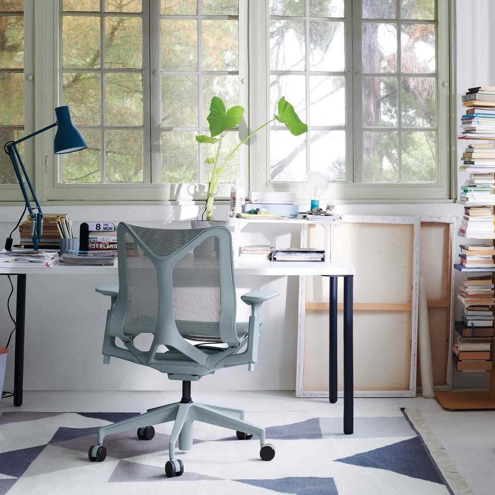 Blue and white OE1 Rectangular Table with a light grey low-back Cosm Chair in a home office setting.