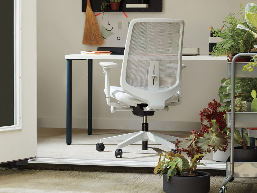 White Verus Chair with blue and white OE1 Rectangular Table in a home office setting.