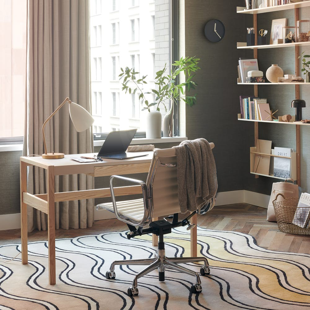 Risom Desk with Eames Aluminum Group Chair and Module Shelving in Office Setting