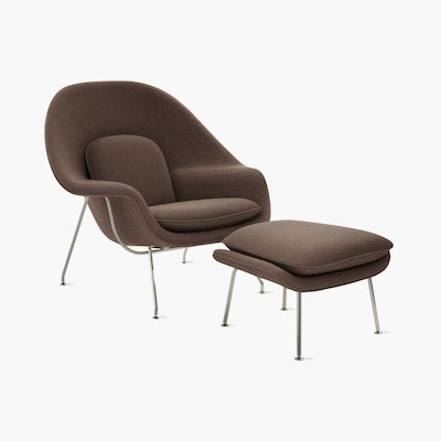 A pumpernickel Womb Chair & Ottoman viewed from an angle